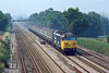 16th Aug 1984:  On a misty day 50044 'Exeter' works the  09.35  from Exeter to Waterloo between Hook and Winchfield.