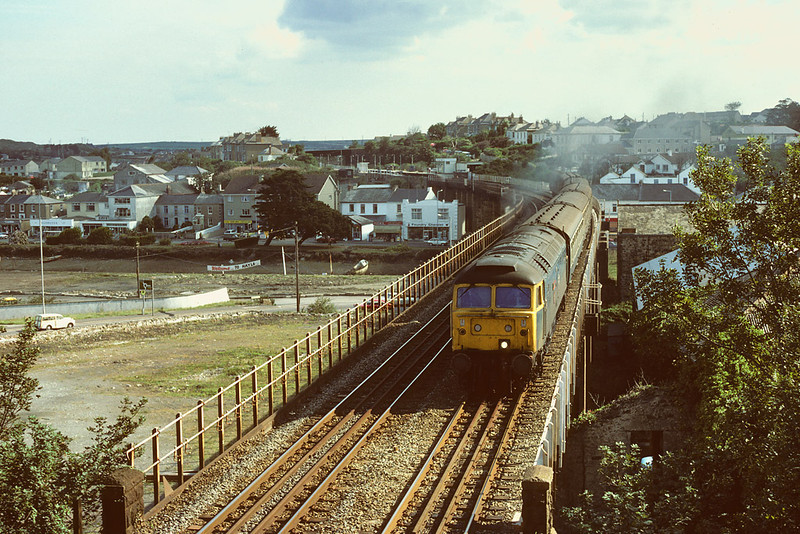 6th Sep 1984: Running over the viaduct at Hayle is 47511 'Tamar' heading for Penzance from Liverpool