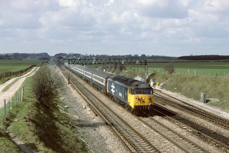 16th Apr 84: 50023 and an Up express at Milley Bridge in Waltham St Lawrence