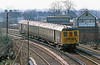 16th Mar 83:  Internal Stores unit 023 takes the Sutton Line at Wimbledon