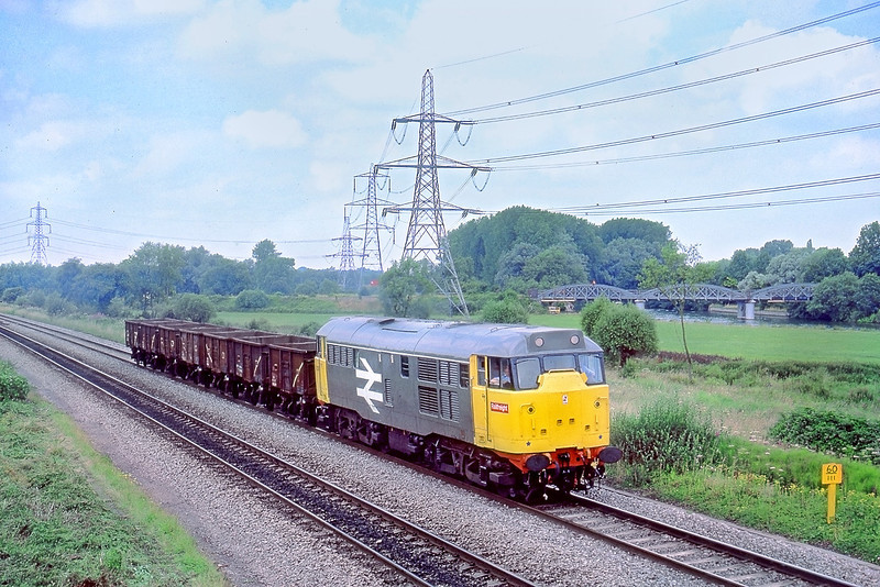 24th Jul 85: 31128 heads south away from Kennington Junction with a short rake of 16 tonners containing spoil