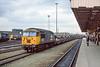 13th Mar 1985:  56102 runs south through Doncaster with a rake of empty Cartics