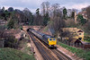 28th Mar 1985:  Leaving the first tunnel after leaving Guildford station is 67619.  It is working the 06.56 from Leeds to Portsmouth