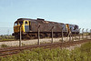 2nd June '85: Ooops! 47590 having suffered a serious fire is towed by 08803 back to Didcot