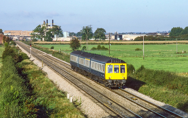 9th Oct 1985:  With the large paper and cardbooard recycling plant in the background at Thatcham  L413 is making for  Reading with the 08.30 from Bedwyn.
