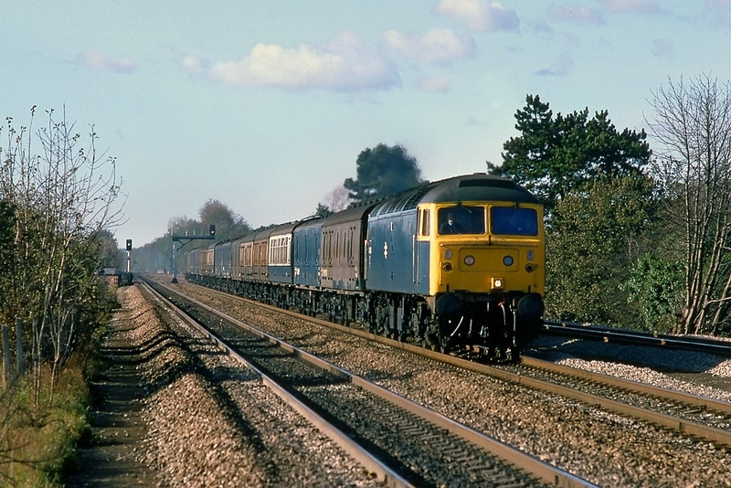 6th Nov 85:  47588 charges to the smoke with a rake of empty newspaper vans.  Captured at Taplow