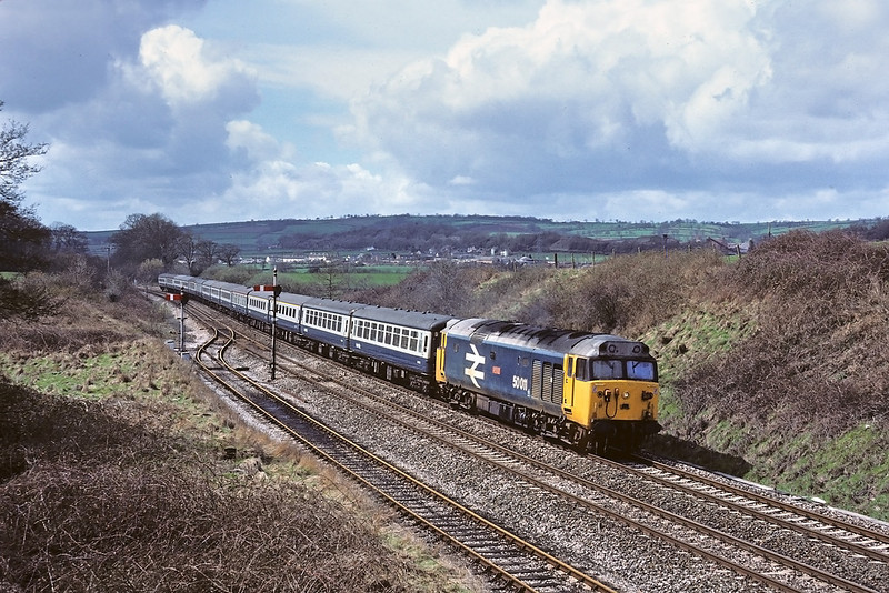 9th Apr '85: 50011 roars up hill through Burlescombe with an Extra for Paddington