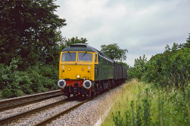27th Aug 1985:  Heading down the grade  from Sapperton through Coates is 47484 'Izambard Kingdom Brunel' with a monster load of THREE vans. There was originally a goods yard at this location.