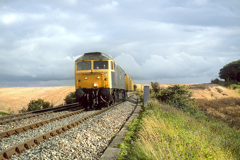 16th Aug 85: 47019 drops down the grade from Upton Scudamore with ARC boxes