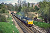 17th Apr 1985:  Taken from Ferry Lane looking back to the first of the tunnels south of Guildord Station sees 47582 'County of Avon'.  The train is the 06.46 from York to Portsmouth