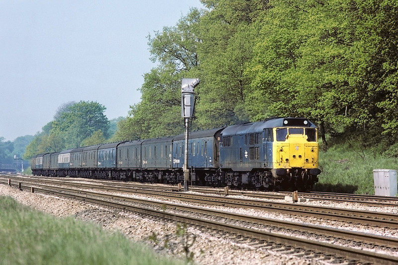 16th May 1985:  31206 brings the Plymouth empty Newspaper vans out of the Sonning Cutting