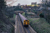 28th Mar 1985:  Between the two tunnels south of Guildford station is 4 CIG, Class 421, 7352 that is working the 10.55 from Portsmouth to Waterloo.