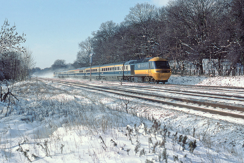 10th Feb 85:  The 09.30 from Weston Super Mare kicks up the snow as it passes Waingels Road at the end of the Sonning Cutting