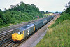 24th Jul 85:  31299 in Railfreight grey livery passes Fox Hall Junction with a parcels train for the west