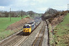 9th Apr 85:  50040 Leviathan roars downhill through Burlescombe with a holiday Extra