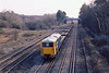 28th Mar 1985:  73140 with a Speedlink Service is on the Down Main through Pirbright.  The distant bridge carries the Up line from Alton which joins these lines at Pirbrighrt Junction about a mile further on.