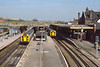 24th Apr 1985:  It is now 10.44 and the 0929 from Portsmouth to Waterloo is in Platform 3,  7030 is in  platform 4 and looks to be going to reverse as the driver can be seen walking back down the platform..  Just visible on the left is a WR servive to Gatwick from Reading