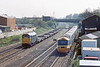 26th Apr 85: 31260 heads for Maidenhead  with Cartics to be loaded with Ford trucks from the Langley plant as the 10.05 to Bristol Temple Meads overtakes on the Main