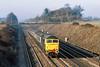 18th Mar 1985:  On the Up Main at Shottesbrooke is 474840 'Isambard  Kingdom Brunel ' is heading  the 06.05 from Westbury to Paddington
