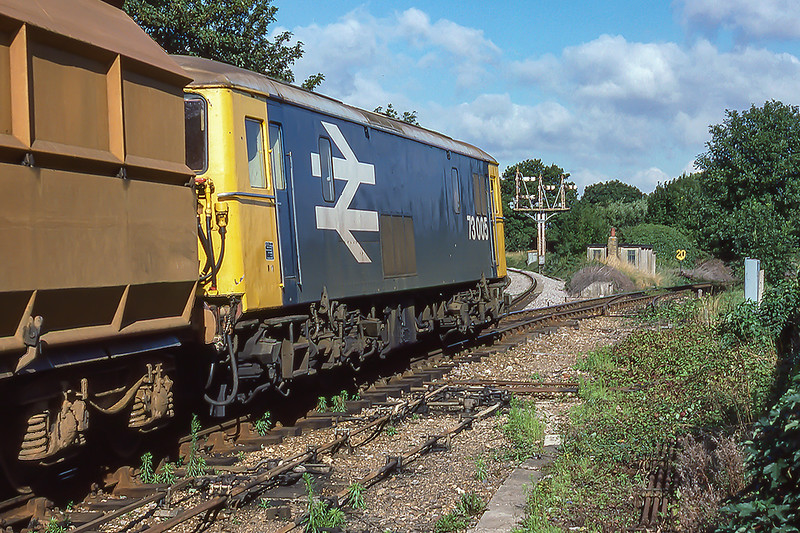 27th Aug 1986: 73005 is entering the branch line  at Fishbourne that originally went to Midhurst from Chichester.  The  train is going a short distance towards Lavant to Francis Agragates depot where it would load gravel.  This it would take to their plant the other side of Chichester