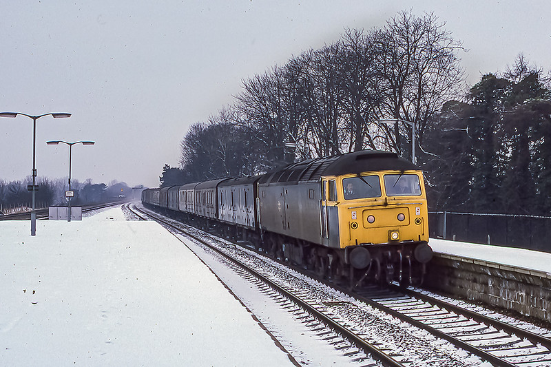 1st Mar 1986:  Ona very cold and very dull morning 46766 is running through Taplow on the Up Relief with empty news vans.  If the loco did not have a yellow front it would have been a monochrome slide on Kodachrome 64 without having to convert it.