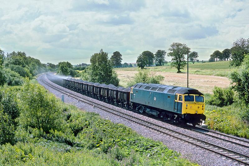 31st Jul 86:  47410 runs downhill near Bedwyn with a load of spent ballast