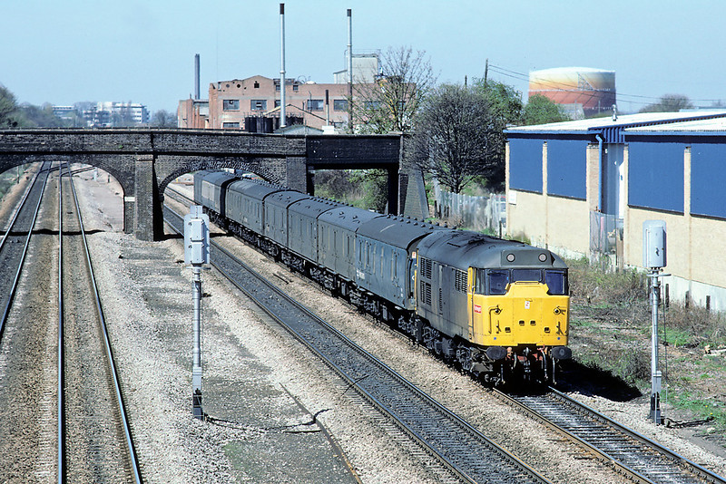 1st May '86: 31161 in Railfreight Grey brings the Plymouth empty Newspaper vans up the Relief towards Langley