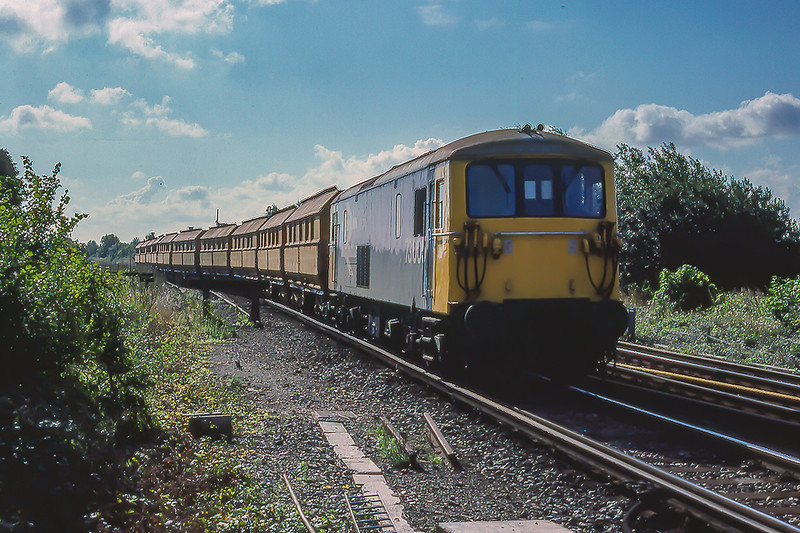 27th Aug 1986:  It is 09.47 and 73005  is crossing over  at Fishbourne so that it can take the line to the Francis Agregate plant near Lavant