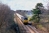 24th Apr 86:  47155 brings a Southampton bound liner across the M3 and through Lyne on the line between Virginia Water and Byfleet & New Haw