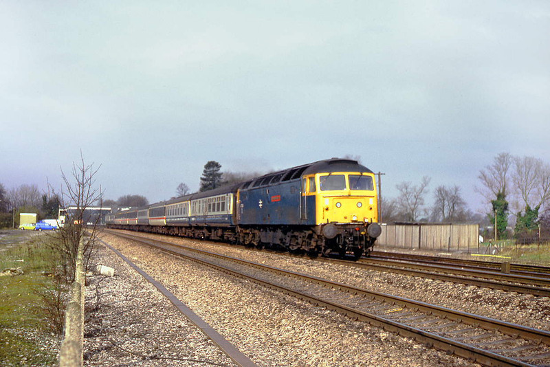 11th Apr 86:  47471 Norman Tunna GC is on the point of the 08.22 from Newbury.  Captured passing the site of the goods yard at Taplow