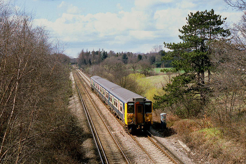 24th Apr 86:  The 13.22 from Staines to Weybridge  formed of 455838 runs through Lyne