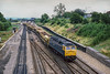 31st Jul 1986:  47245 with a mixed rake of Associated Road Construction hoppers bound for Whatley Quarry is laddering over to the main line at Foxhall Junction.  A shame about the crap light.