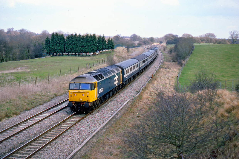 4th Apr 86:; 47633 crosses Hungerford Common heading the 2.45pm Paddington to Plymouth
