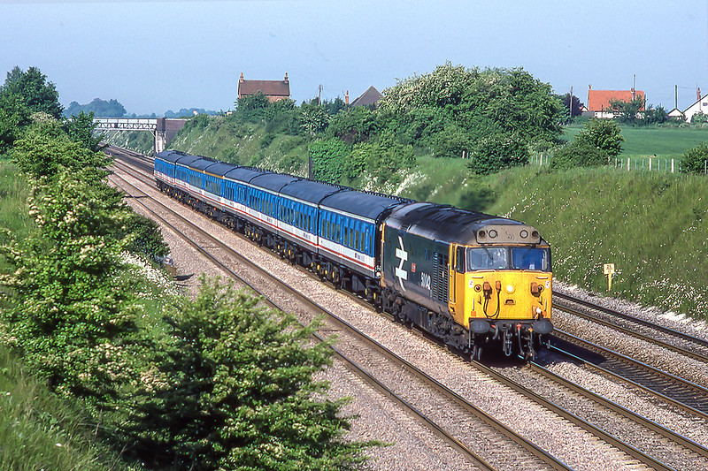 13th Jun 1986:  With a complete rake of Mark 1 coaches in Network South East livery '50042 'Triumph' is at White Waltham