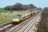 29th Apr '86:  Grey Grid 56033  brings empty Hoppers towards Milley Bridge at Waltham St Lawrence