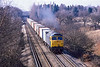 7th Mar 1986:  At  13.45  47146 is crossing the M3 at Lyne as it works a freightliner to Southampton  from  the East London area.