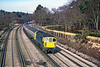29th Apr 1986:  Pictured 13.59 from Curzon Bridge in Pirbright is 33102 wi=ty a pair of TCs in tow forming a Salisbury to Waterloo service.  The Basingstoke Canal can be seen on the right and the big dirty splodge in the foreground is actually a Flange Greaser that had been temoved from the Down Fast line.