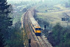 2nd May 1986::    73127 is crossing the M25 at Merstham as it works the 11.05 from Gatwick to `Victoria.  Whenever I had to chance to take a picture here it was always misty !