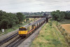 31st Jul 1986:  One hour and thirty two minutes after I pictured 58023 entering Didcot Power Station at three minutes past seven it is at Didcot Noorth Junction with the empty HAAs