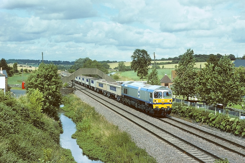 31st Jul 86: 59003 Western Highlander now resident in Germany brings Yeoman boxes up the Hill though Little Bedwyn.  2015: now back home but working for GBRf
