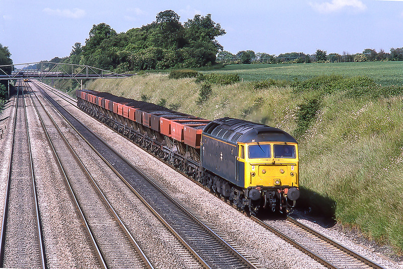 12th Jun 1987:   Another traffic that has vanished is the movement of domestic coal.  47597 is heading for London as it passes through Shottesbrooke  between Twyford and Maidenhead.