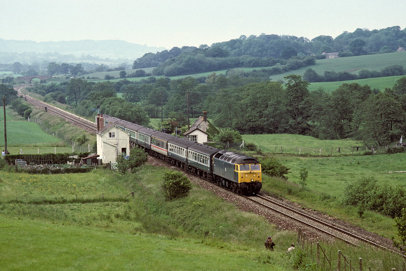 13th Jun 87- Un unknown 47 on an Exeter to Brighton service passes Tisbury Gates