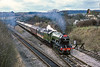 1st Mar 1987:   Running down the slope into Prines Risborough with 'The Shakespeare Express' is  4472 'Flying Scotsman'.  Behind the loco is 'Ethel' whose purpose is to geneate electricity  and provide heating for the coaches,