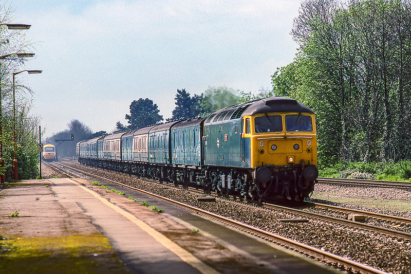 17th Mar 1988:  On the Up Main at Taplow is 47609 'Fire Fly' with eleven non passenger carrying vehicles in tpw