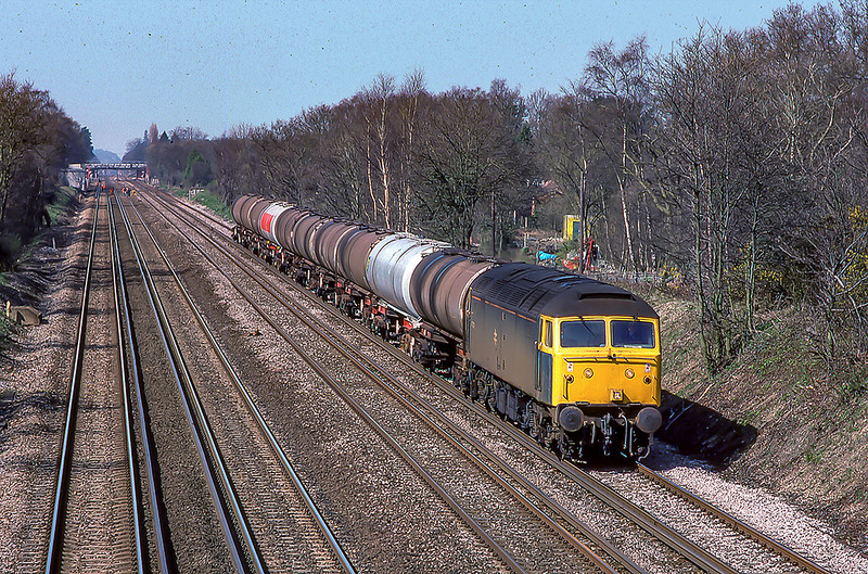 11th Apr 1988:  47270 is on the up slow line between Fleet and Farnborough with empty ioil tanks from Micheldever to Thames Haven