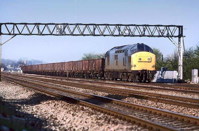 12th Apr 1988:  With Ruscombe in the background 37306 is on the Up Relief with a load of spent ballast