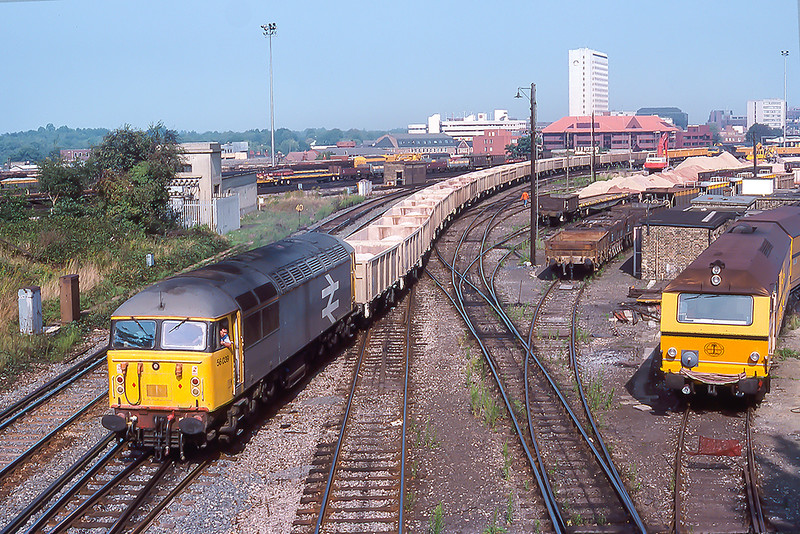 19th Sep 1988:  56039 is shunting  the recently arrived stone from Merehead back into the Down Yard in Woking.  The boxes  do not look vey  well loaded.