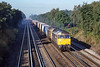 30th Sep 1988:  With Fleet station in the distance 47419 7 & 47428  head a freightliner on the Up Main towards London through Pystock.