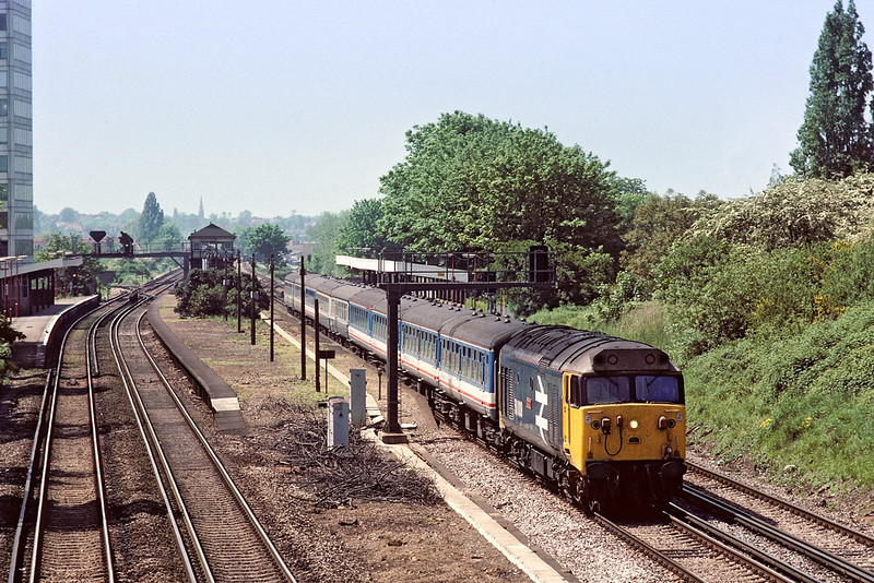 17th May '88: 50009 'Conquerer' heads an Exeter to Waterloo service through New Malden