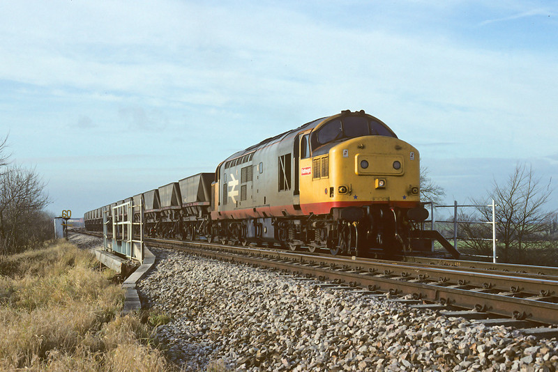 9th Dec 88:  37374 is crossing Coach Road on the Approach to Westbury Cement Works  with coal from South Wales